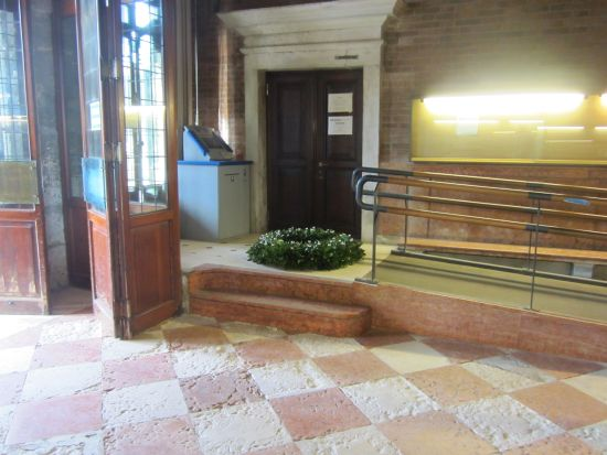 "I was surprised to see the commemorative wreath lying peacefully in the entryway of Ca' Farsetti, the city hall, on the evening before it was to be offered to the waves in memory of fallen sailors at the ""Sposalizio del Mare."""