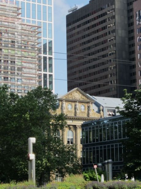The financial center retains a few 19th-century buildings which survived bombing in World War II.