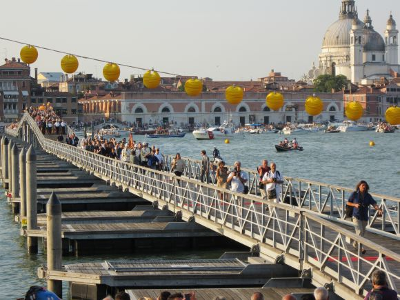 The votive bridge opened at 7:00 PM on a sweltering Saturday evening -- the procession led by the usual authorities such as mayor, patriarch, various people in uniforms, marching across the Giudecca Canal to the church.