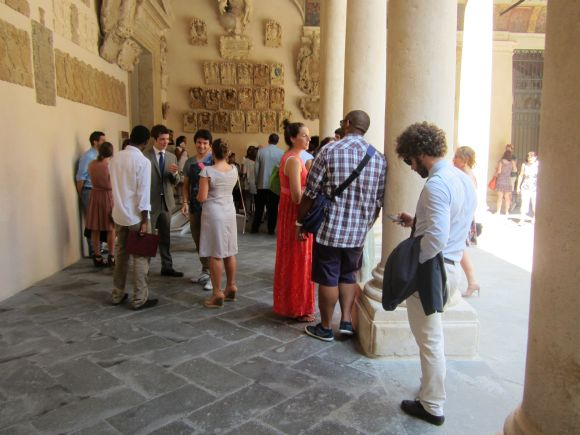 The group of his faithful followers and family, bunched together with him inside the Palazzo, as he waited to be called.