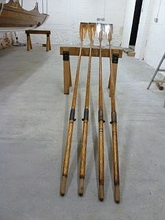 "These are ""Cherub""'s oars in happier days."