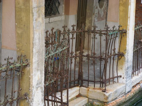 Which degradation is more disturbing? The kind shown here? (Anyone who considers the condition of this once-beautiful wrought iron to be charming can skip to the next question).......