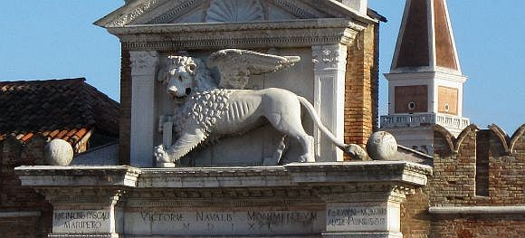 This is the lion that triumphantly tops the entrance to the Arsenal, placed (with Santa Giustina above) in commemoration of the victory of the Battle of Lepanto. I've photographed him many times, but the other morning he was looking exceptionally crisp. Perhaps he'd been starched and ironed.