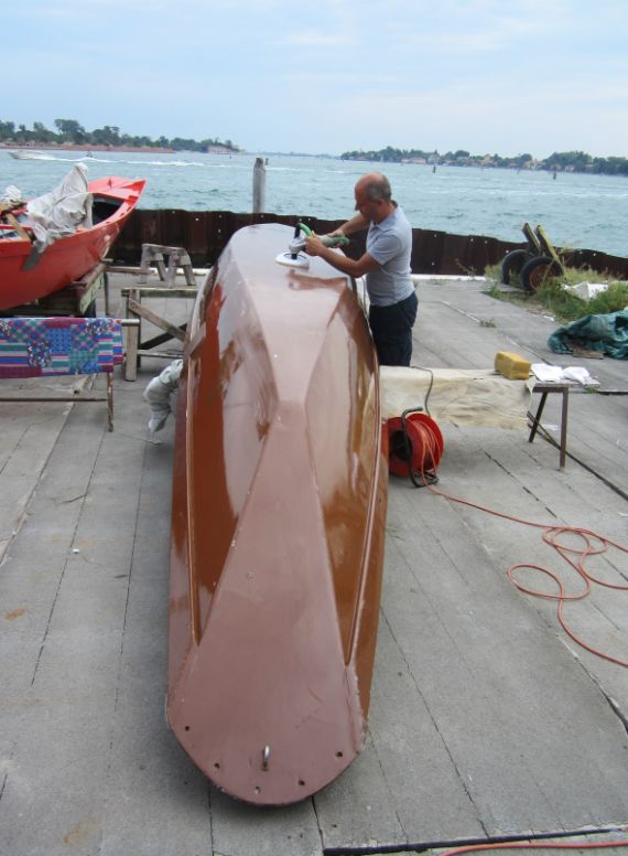 The final touch is buffing the wax that you applied yesterday.  Unfortunately, the wax isn't the only factor that helps you go faster, as the boys on this boat discovered.