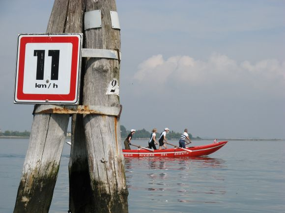 I presume the red boat was staying within the posted speed limit; it would have been hard to have exceeded it.