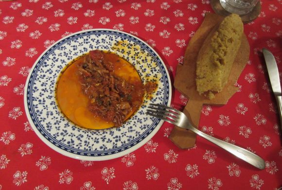 This was dinner last night: polenta and baccala'.  Made for each other, like porkchops and applesauce.  We recognize that the sauce is a little thinner than it should be, but that didn't handicap the soaking-up operation.