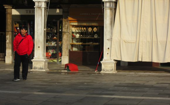 What are the odds of getting a red tourist, carpet and broom in the same frame? In the Piazza San Marco, the odds appear to be excellent.