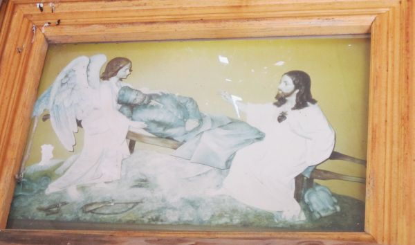 This image is hung on the wall facing the altar, up under the eaves.