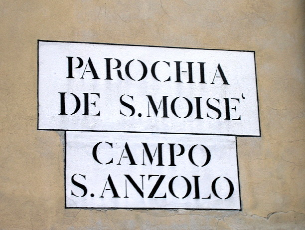 "An example of a nizioleto in flawless Venetian.  If it were in Italian, it would read ""Parrochia di S. Moise',"" and ""Campo Sant' Angelo.""  Parish of San Moise', camp of Saint Angelo.  Is this hard to read?  Confusing?  Bizarre?  Not to speakers of Venetian, of which Venice is still full."