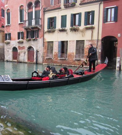 The gondolier bringing his clients back to shore removed his hat.