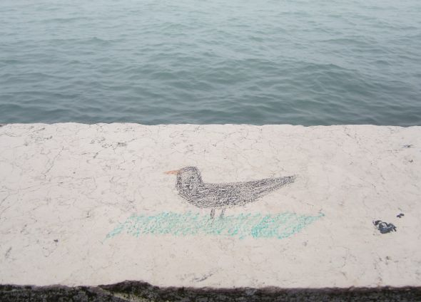 Obviously not Shelley's famous skylark, but for me the unmistakable outline and color of the blackbird does the same job for me.  Whether this bird's spirit is blithe maybe open to discussion, but I'm enchanted by whoever  created this image on the parapet by the Giardini.  Sing on!