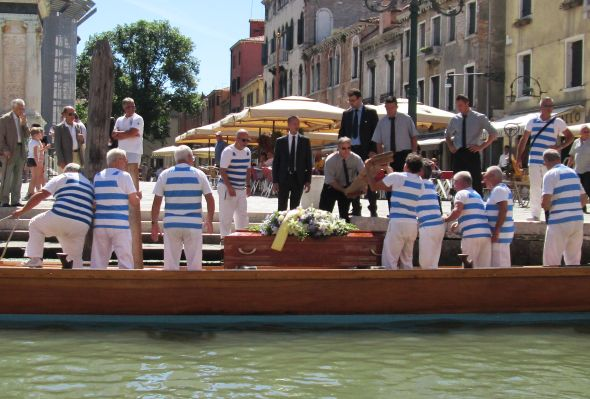 "No matter how glamorous the boat -- here, the ""disdotona"" of the Querini rowing club -- a coffin is still just that.  Odd how death itself turns out to be such a useful concept for expressing things about life."