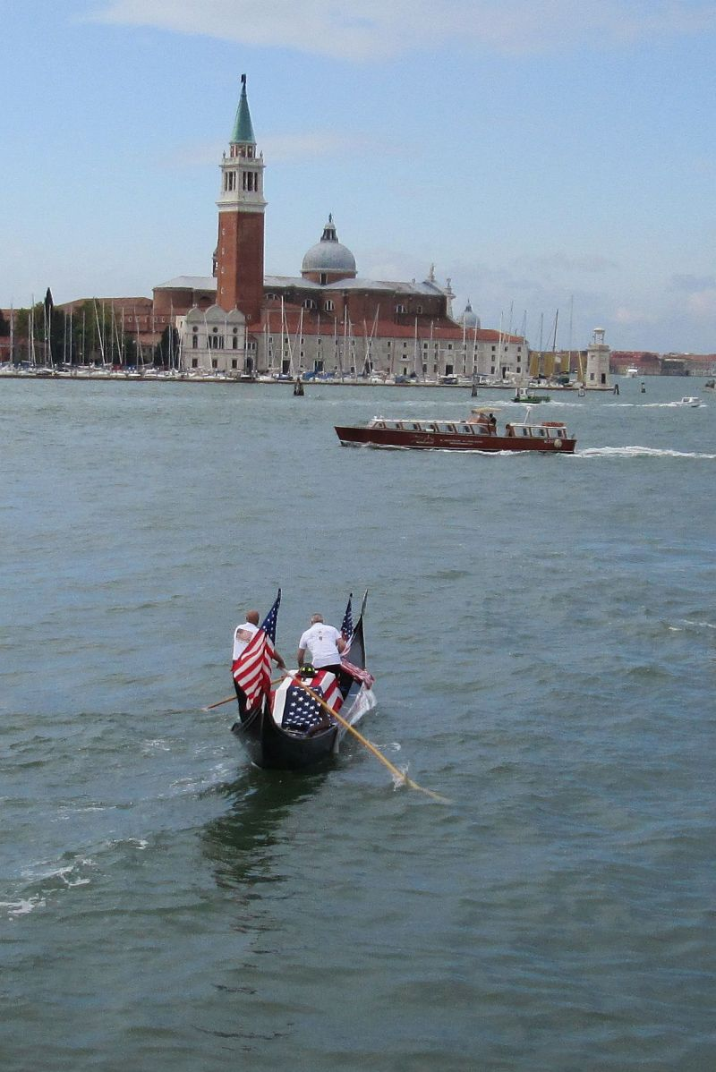 Vittorio Orio on the stern of his gondola, rowing with a partner across the Bacino of San Marco toward some distant point.  Perhaps the basilica of the Madonna della Salute, maybe the length of the Grand Canal.  The point is, he went.