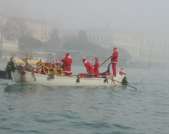 "Floating around while waiting for the official start (""official"" being whenever somebody said ""We're ready, let's go""), this batch of Saint Nicks had time to make sure their reindeer was comfortable at the bow."
