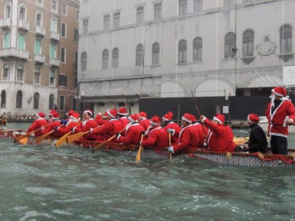 Not strictly Venetian, but any boat bearing a Saint Nicholas is welcome at the party.  If this boat were to capsize, they'd all be bobbing around like Yuletide buoys.