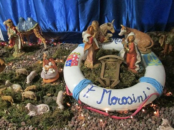 One creche (or presepe, as it's called here) isn't enough at the Naval School, where the chaplain and cadets put heart, soul and all sorts of useful bric-a-brac into their scenes. The lifebuoy adds a touch of metaphor to the arrangement. As is usual, the figure of the Bambin Gesu' is only installed on Christmas Day.