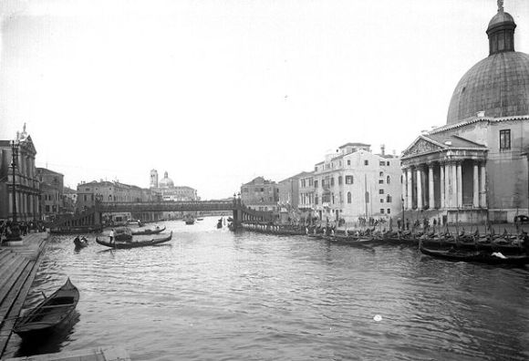 This is the Scalzi Bridge, linking the fondamenta of the train station to the fondamenta of the rest of Venice.  Today we know it as a gracefully arched marble bridge, but from the mid-1800s to the early 1930s, the bridge looked like this.  (as did the Accademia Bridge).