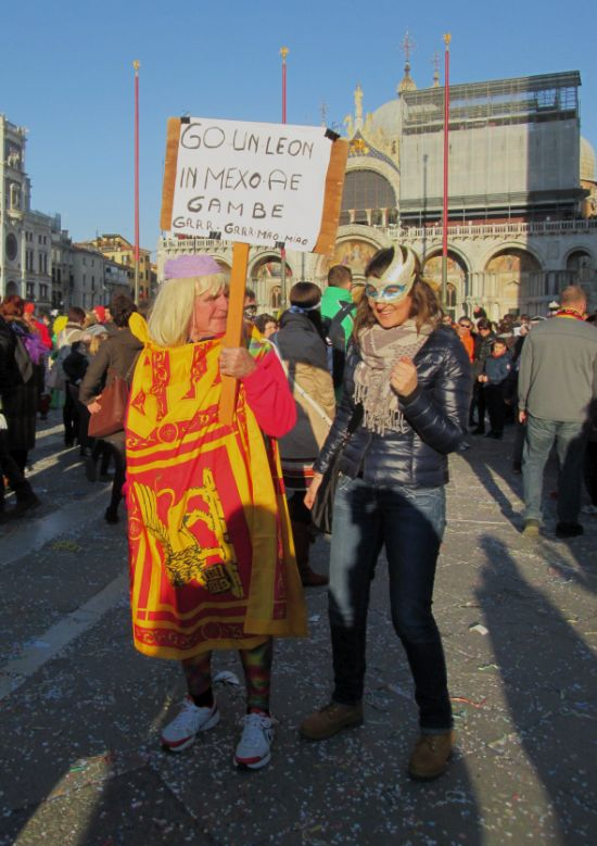 "On the other end of the spectrum was this homegrown marvel, whose costume basically means nothing and whose sign (in Venetian) translates as: I've got a lion between my leg, grr grr meow meow.""  Still, people were happy to be photographed with him, even if they didn't know what it said."