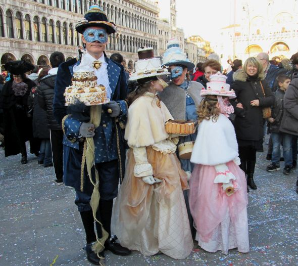 This astonishing family seems to have been born and bred in a pastry shop.  First I thought the cakes were fake, but now I'm not so sure.  If the hats are real, I want to be there when they bet against eating them.
