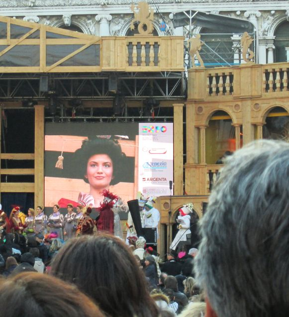 And here is Irene Rizzi, the Maria of 2015, bigger than life on the jumbotron behind the stage.  She's all decked out in some Chinese headdress for reasons that were unclear, though the presenters were babbling something about Marco Polo and the spice trade.