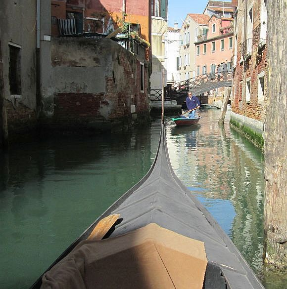 "Lino and I rowed the gondola over to our next location, behind Campo SS. Giovanni e Paolo, where it was our turn to wait.  Just think: Somebody came rowing by that Lino knows. They exchanged variationson the ""What are you doing here?"" theme and the friend rowed on."