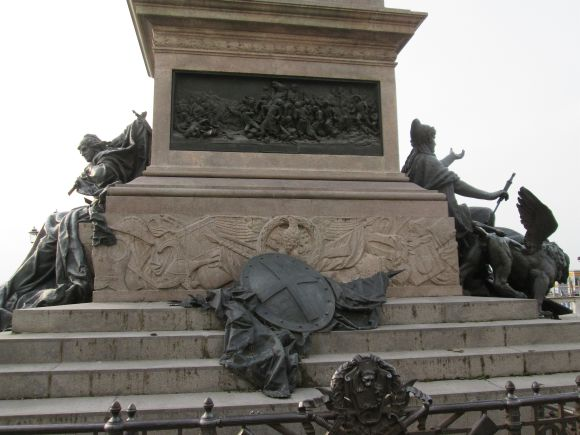 On the north side is the shield of the House of Savoy, and above it a tangled scene in low relief which shows the future King in the process of winning the battle of TK.