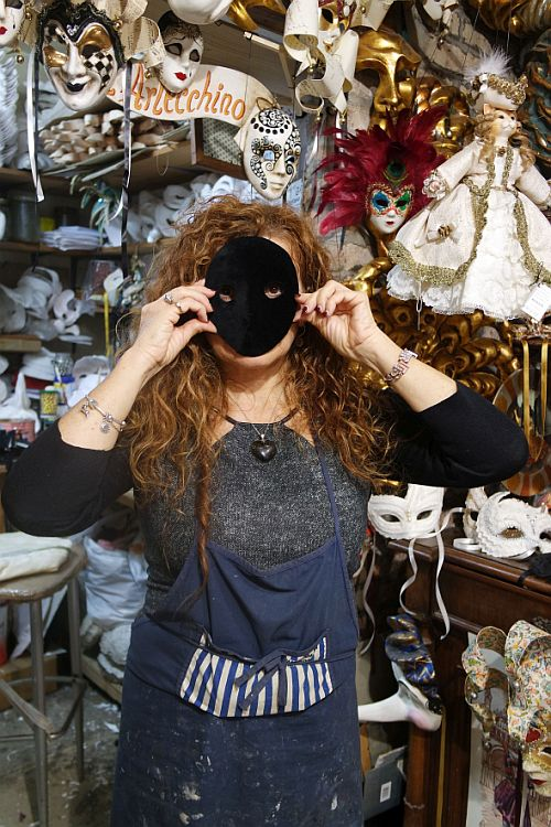 "Marilisa Dal Cason at ""L'Arlecchino"" makes the traditional masks, but is one of the few who also makes the classic ""Moreta,"" a black velvet oval held in place by a button clenched in the lady's teeth."