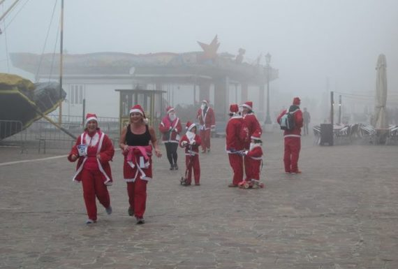 If this Santa hasn't run to Venice straight from the North Pole, she at least must come from Hammerfest, where weather like this qualifies as a heat wave.